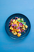 Red lentil salad with colourful cauliflower, sumach and Vietnamese coriander (vegan)