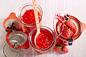 Jars of strawberry and carrot jam with decorations