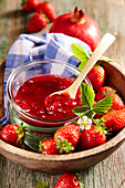 Pomegranate and strawberry jam with fresh fruit