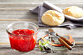 Strawberry and banana jam with bread rolls