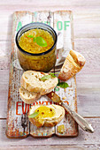 Courgette and pineapple jam in a jar and on a slice of white bread