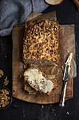 Rustic walnut bread with cheese and a slice of butter