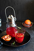 Homemade blood orangeade with rosemary