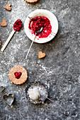 Linzer cookies made of hazelnut dough with raspberry jam