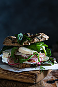 Spelt rolls with cheese, radishes and salad