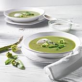 Cream of pea and romanesco soup with crème fraîche