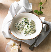 Cream cheese and spinach gnocchi with Parmesan