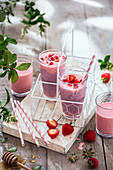 Strawberry drinking yoghurt in serving glasses in a shade