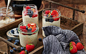 Fruity millet porridge with mixed berries in a mason jar