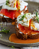 Bruschettas with cream cheese, salmon and poached eggs