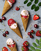 Strawberry and cherry ice-cream cones