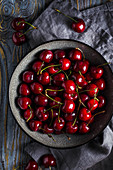 Sweet cherry in a bowl on a wooden table