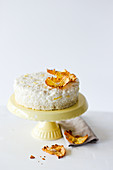 Rice pudding cake with pineapple on a cake stand