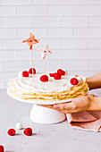 Pancake cake with raspberries and cream cheese