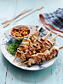 Hawker stall style chicken kebab with a satay dip (China)