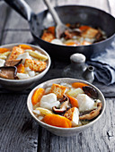 Hearty fish stew with mushrooms and carrots (Asia)