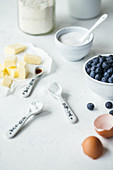 Ingredients for blueberry tarts with shortcrust pastry