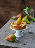 A tartlet with braised mini pears in vanilla and caramel sauce with pistachios