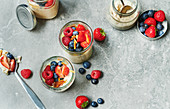 Fruity millet porridge with mixed berries in preserving jars