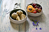 Vegan potato dumplings with pumpkin seed crumbs, and a bowl of fruit