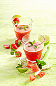 Frosted watermelon strawberry mojito with mint and lime