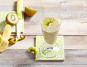 Fresh kiwi smoothie, with banana and apple juice