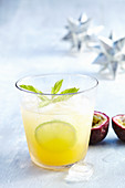 Passion fruit Spritz with pineapple juice, orange, lime and mineral water