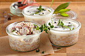 Pork rillettes canned in mason jars with fresh herbs