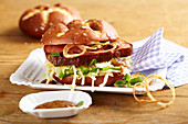 Lye bread with meatloaf, coleslaw and sweet mustard