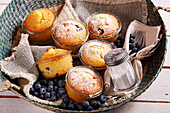 Small blueberry pie baked in a glasses to take away