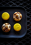 Yellow macarons and almond chocolate tarts