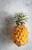 A pineapple on a marble table