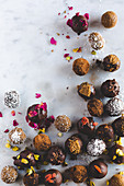 Various chocolate truffles on a marble surface