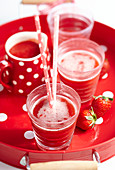 Strawberry iced tea with peppermint on a red tray