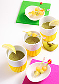 Kiwi and melon smoothie shots with fruit skewers