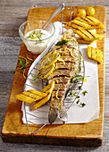 A whole grilled bass with polenta and lemon mayonnaise