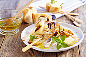 Grilled king trumpet mushroom skewers with lemon oil