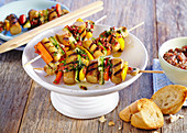 Grilled tofu sausage and vegetable skewers with white bread