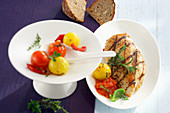 Grilled, marinated chicken breast with braised tomatoes and sunflower-seed bread