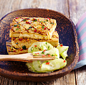 Grilled tofu in an oriental marinade and a spicy cucumber salad