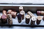 Wine corks on a window sill