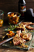 Grilled lamb chops in a beer marinade with potato wedges