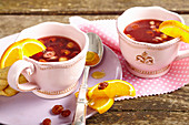 Swedish alcohol-free hazelnut punch with oranges, sultanas, raspberry tea and honey