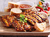 Grilled spicy spare ribs with a Caribbean marinade, coriander and white bread