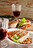 Grilled red Mexican snapper with jalapenos, coriander and red wine