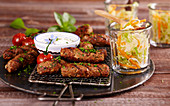 Grilled beef cevapcici with coleslaw and a yoghurt and garlic sauce