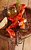 Grilled mini pointed peppers filled with feta cheese, white bread and thyme