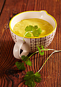 Exotic curried banana sauce with coriander for a fondue