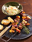 Grilled apple and pork skewers with coleslaw and grilled white bread