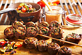 Grilled roulade skewers with Mediterranean vegetables and spicy BBQ sauce